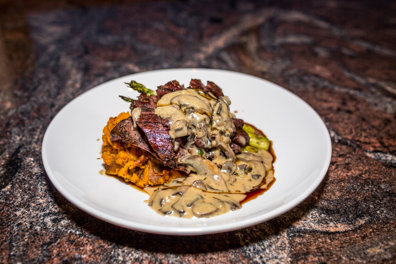 Skirt steak: mashed sweet potatoes, crispy carrot, saba, wood-grilled asparagus, and mushroom ragu / Image: Catherine Viox // Published: 9.5.19