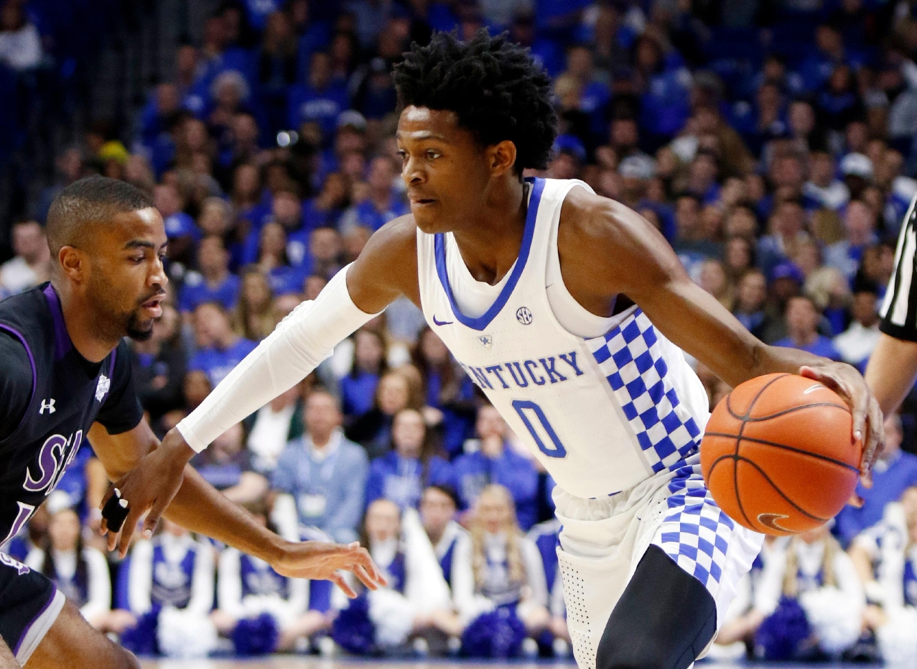 Kentucky's De'Aaron Fox, right, looks for an opening around Stephen F. Austin's Dallas Cameron during the first half of an NCAA college basketball game, Friday, Nov. 11, 2016, in Lexington, Ky. (AP Photo/James Crisp)