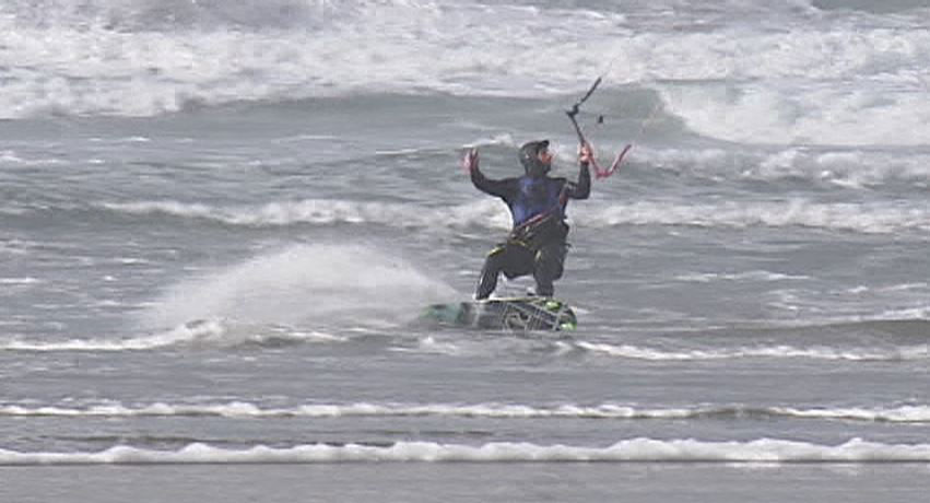 Got wind? Will kiteboard: Some hearty souls hit the beach Thursday as wind hit the Oregon Coast.