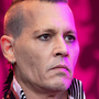 Johnny Depp defends acting with an earpiece