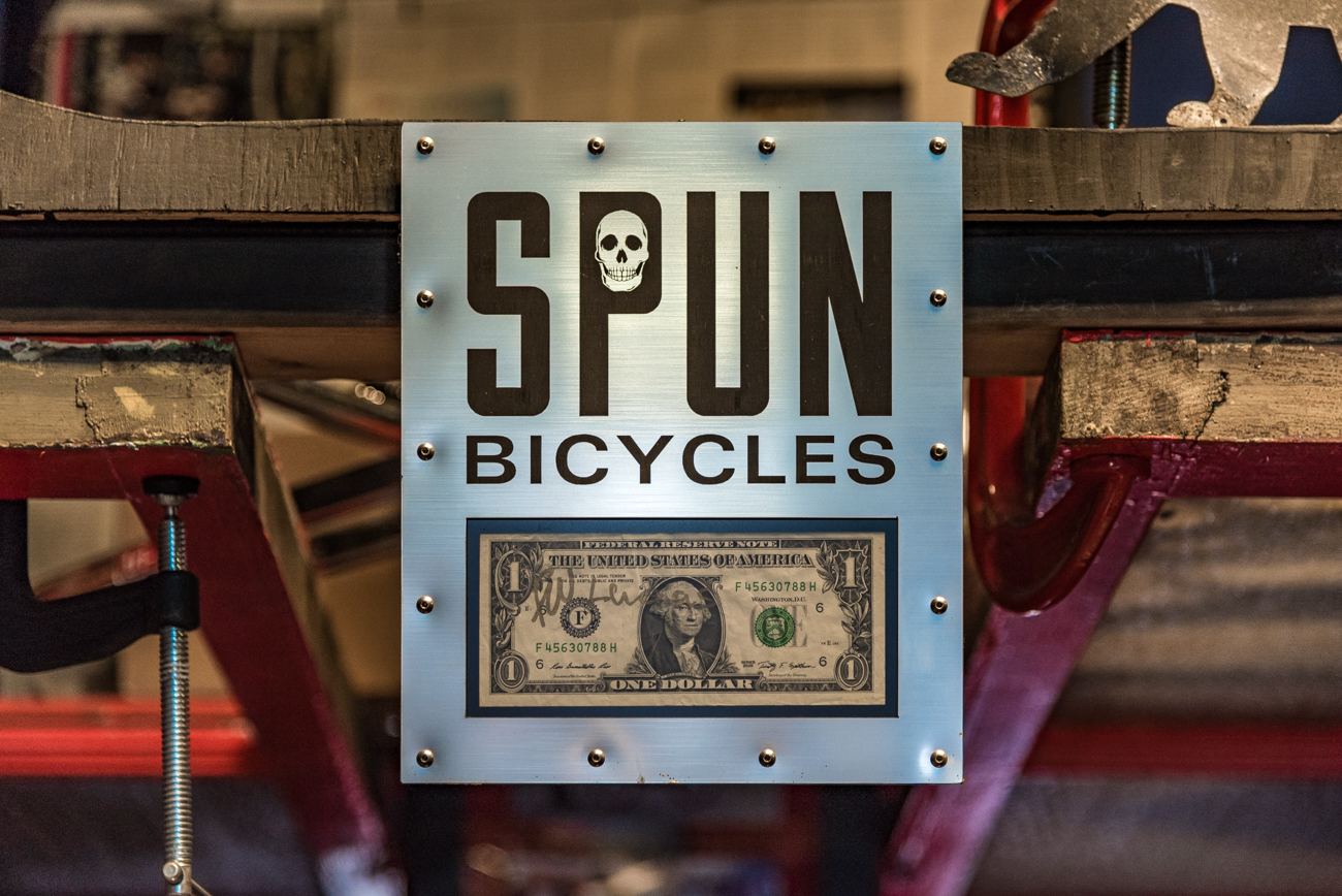 SPUN's first dollar earned is displayed prominently above the back counter. / Image: Phil Armstrong, Cincinnati Refined // Published: 3.19.17