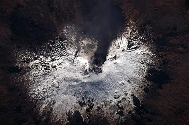 Mt Etna, pouring heat and steam and smoke up through the snowcap. Earth never ceases to amaze. (Photo & Caption: Chris Hadfield/NASA)