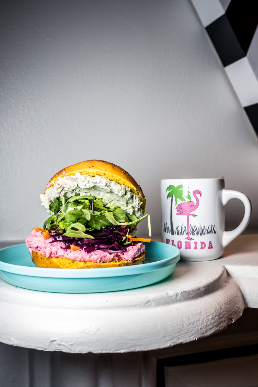 The Bad Judy: beet & veggie spread, mint chutney spread, spicy greens, pickled carrots, and kraut on a spicy turmeric beet bagel / Image: Catherine Viox{ }// Published: 7.24.20
