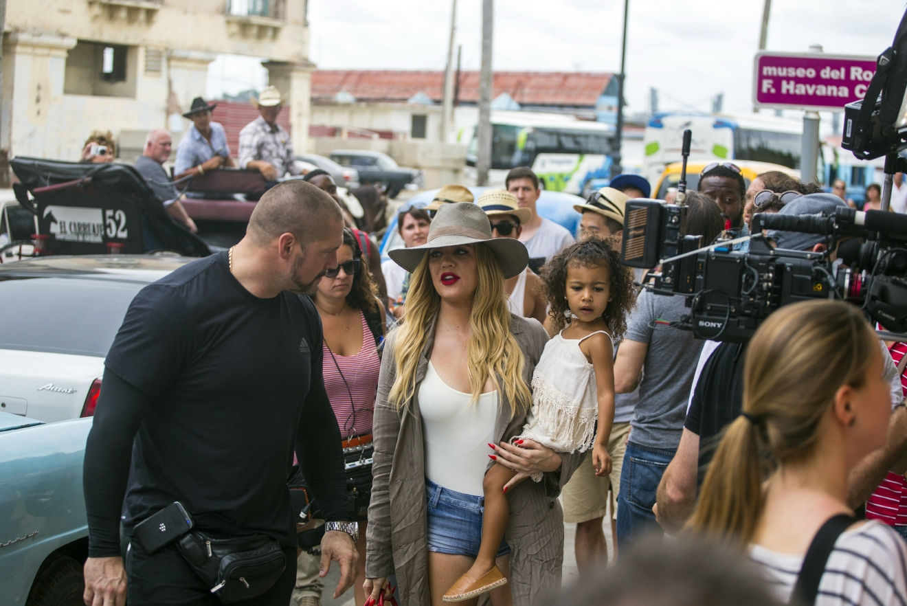 American entrepreneur and television personality Khloe Kardashian Odom holds a child, as she prepares to enter the Havana Club Rum Museum in Havana, Cuba, Wednesday, May 4, 2016. Khloe and the rest of the Kardashian clan are some of the famous entertainment figures to visit the island, since the declaration of detente with the U.S. in December 2014. (AP Photo/Desmond Boylan)