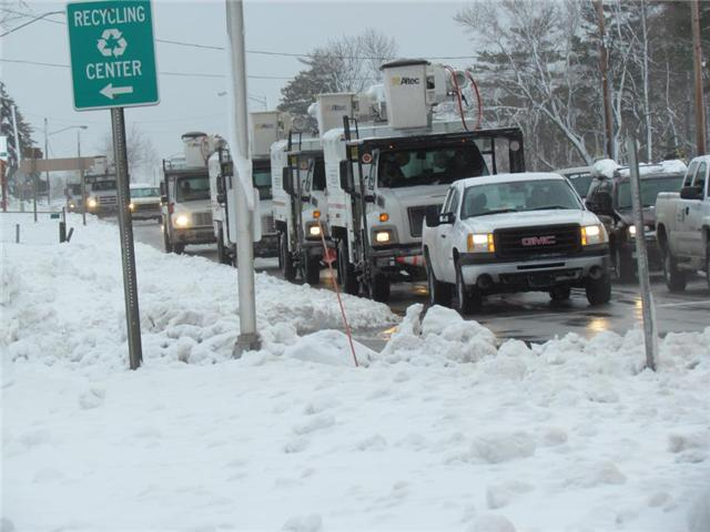 A caravan of utility trucks heading north on U.S. 31 Saturday afternoon.