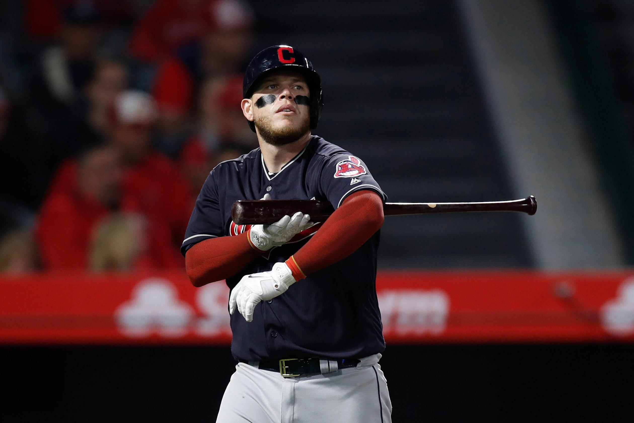 Cleveland Indians' Roberto Perez walks off the field after striking out during the sixth inning of a baseball game against the Los Angeles Angels, Tuesday, April 3, 2018, in Anaheim, Calif. (AP Photo/Jae C. Hong)