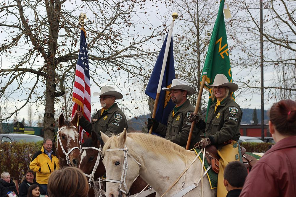 The Sheriff�s Department marched in the 63rd Annual Springfield Christmas Parade in Springfield, Ore., Saturday, Dec. 5. Photo by Claire Aubin.