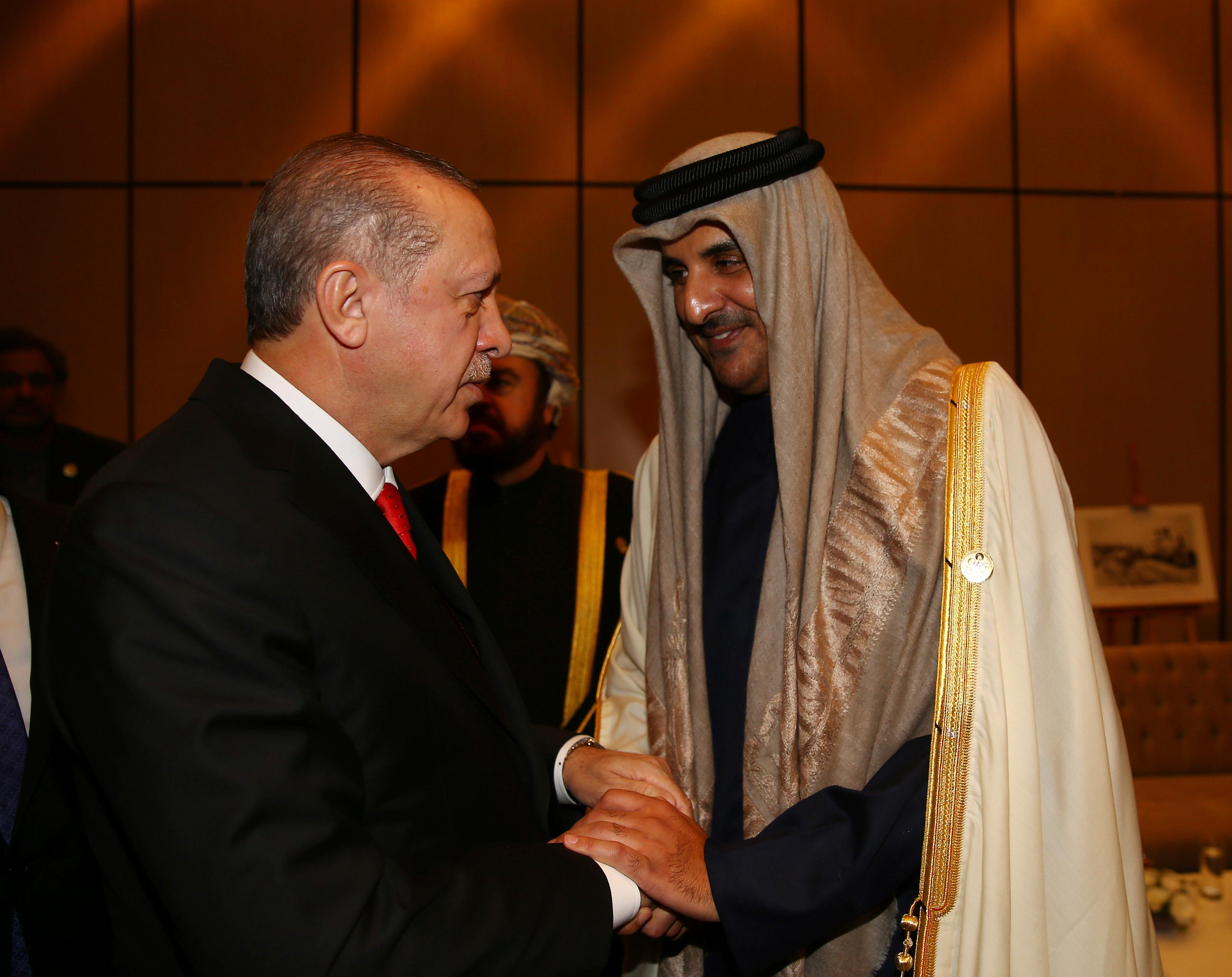 Turkey's President Recep Tayyip Erdogan, left, welcomes Qatar's Emir, Sheikh Tamim Bin Hamad Al Thani, right, prior to the opening session of the Organisation of Islamic Cooperation Extraordinary Summit in Istanbul, Wednesday, Dec. 13, 2017. The Istanbul gathering of heads of state and top officials from the 57-member Organisation of Islamic Cooperation could offer the Muslim world's strongest response yet to U.S. President Donald Trump's recognition of Jerusalem as the capital of Israel.(Kayhan Ozer/Pool Photo via AP)