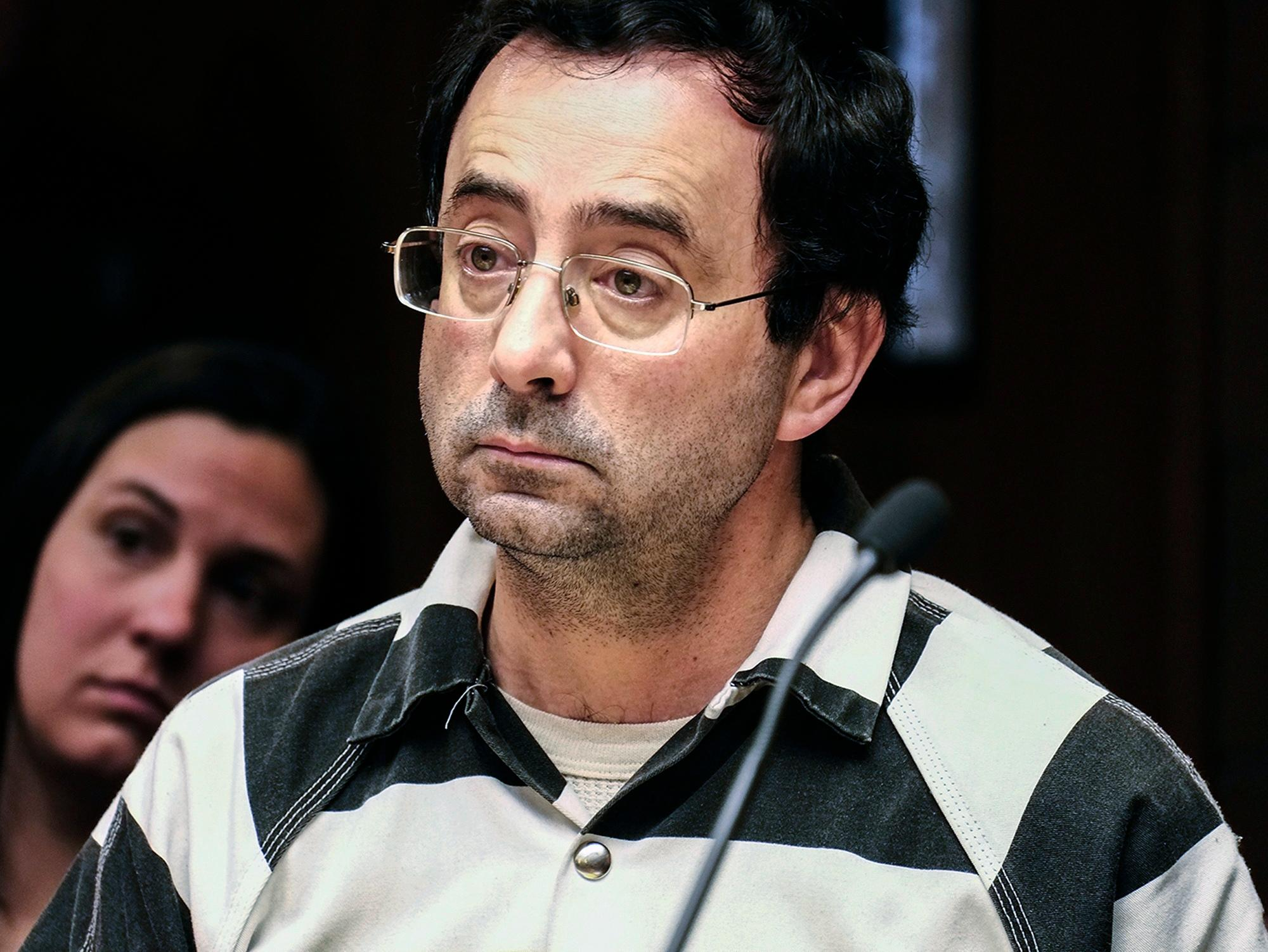 FILE - In this Feb. 17, 2017, file photo, Dr. Larry Nassar listens to testimony of a witness during a preliminary hearing, in Lansing, Mich.{&amp;nbsp;} (Robert Killips  /Lansing State Journal via AP, File)<p></p>