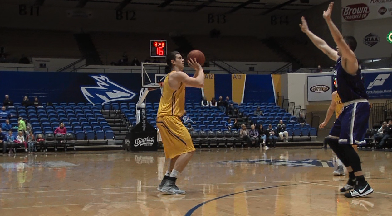 UNK Forward Trey Lansman prepares to shoot a three pointer during a recent game at the Health and Sports Center. (KHGI)<p></p>