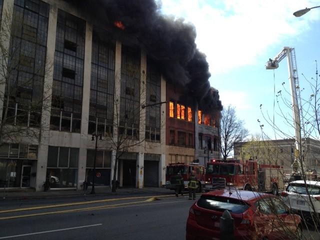 Thick, black smoke billows from a building on fire in downtown Birmingham on Friday, March 29, 2013.