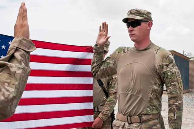 U.S. Army Sgt. Dillon Diener recites the oath of enlistment on Forward Operating Base Apache in Afghanistan's Zabul province, Aug. 4, 2013. Diener is the security team squad leader for Company C, 2nd Battalion, 2nd Infantry Regiment.