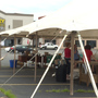 Damaged by tornado, Ashley Furniture hosts tent sale in parking lot