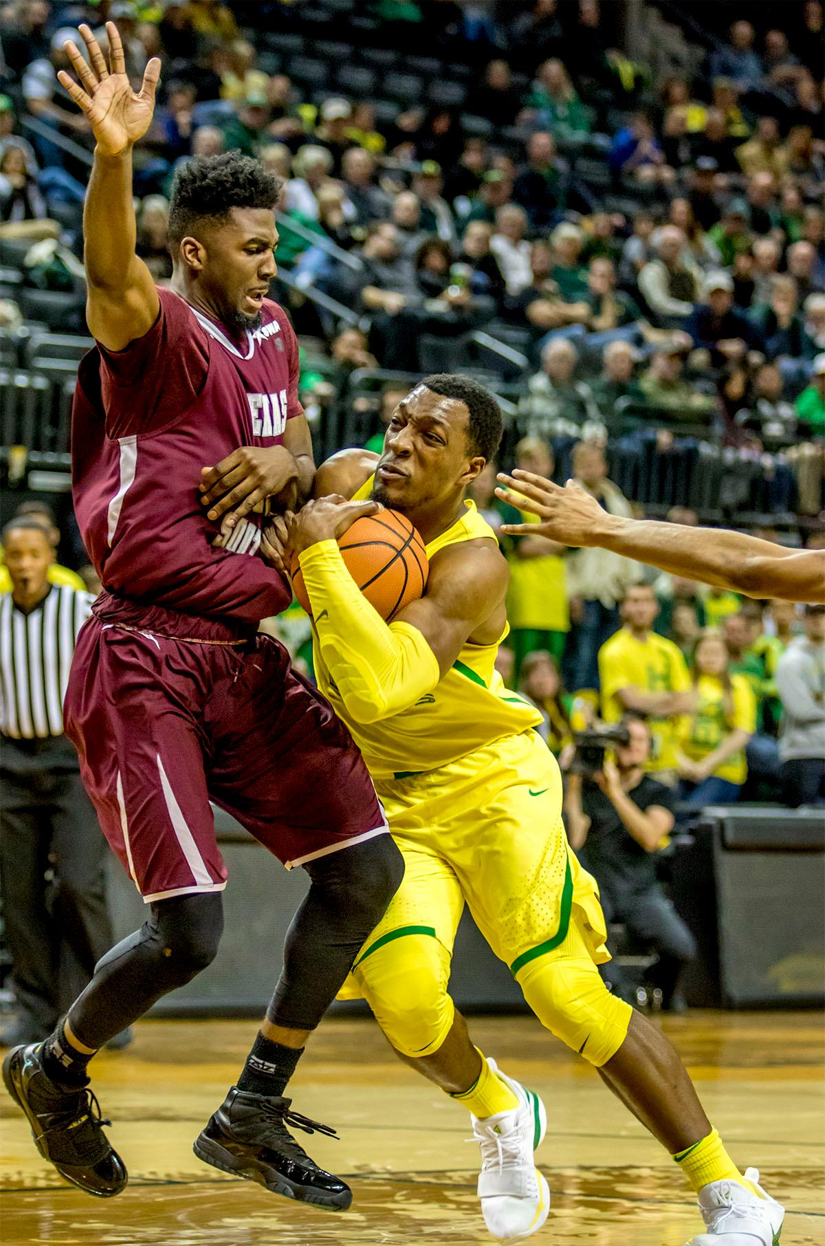 The Duck's MiKyle McIntosh (#22) pushes his way towards the basket. The Oregon Ducks defeated Texas Southern Tigers 74-68. The Ducks are now 7-3 overall in the Pac-12. Photo by August Frank. Oregon News Lab