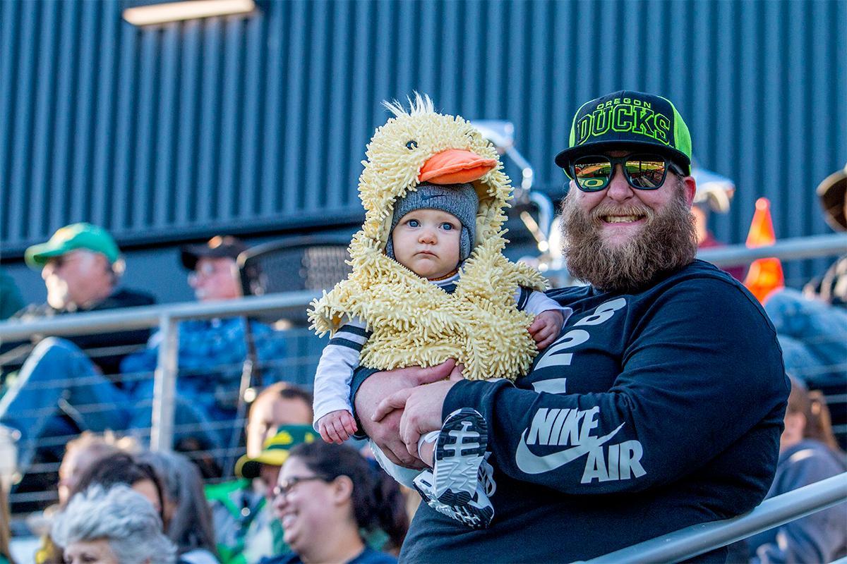 A fan in the crowd has his baby dressed for the occasion in a duck outfit. The Oregon Ducks defeated the Oregon State Beavers 8-0 in game one of the three-game Civil War series on Friday night at Jane Sanders Stadium. The game was 0-0 until Gwen Svekis (#21) hit a solo home run in the fourth inning. Mia Camuso hit a grand slam in the fifth inning, ending the game for the Ducks by mercy rule. With tonight's victory, the Ducks are 39-6 and 12-6 in Pac-12 play. Photo by August Frank, Oregon News Lab