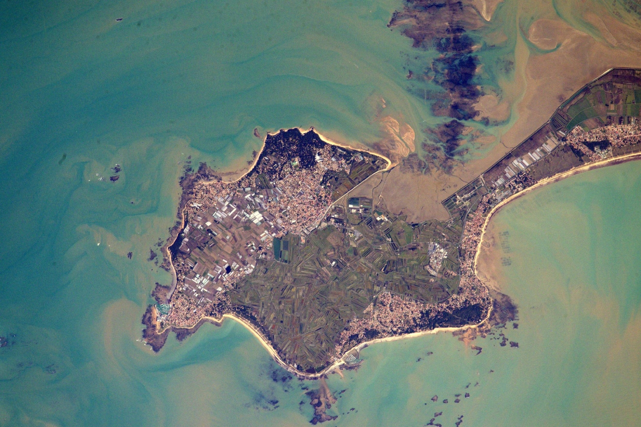 I?le de Noirmoutier has a famous road that is submerged at high-tide. I remember that road as a kid. (Photo & Caption: Thomas Pesquet // NASA)