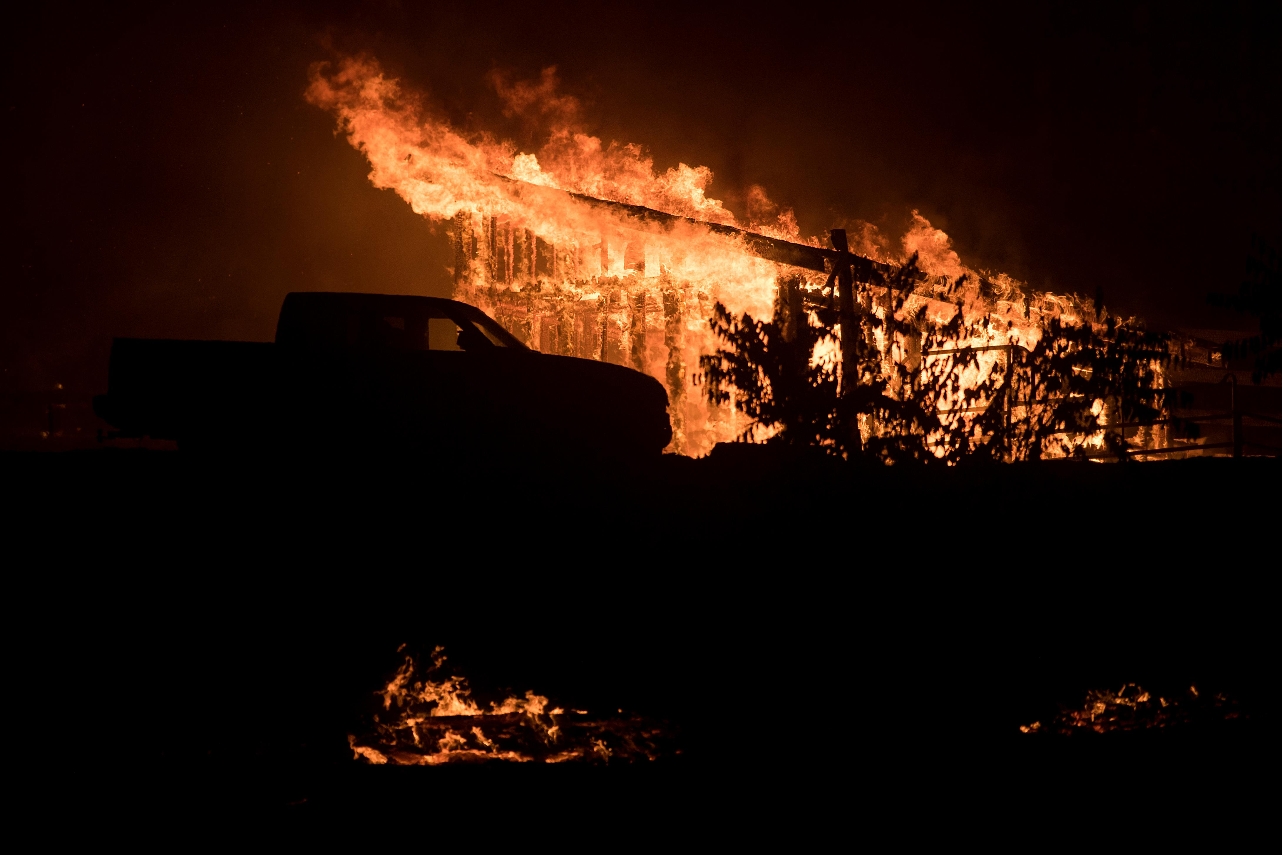 Flames consume a structure as a wildfire burns in Casitas Springs, Calif., on Tuesday, Dec. 5, 2017. Wind-driven fires tore through California communities Tuesday for the second time in two months, leaving hundreds of homes feared lost and uprooting tens of thousands of people. (AP Photo/Noah Berger)
