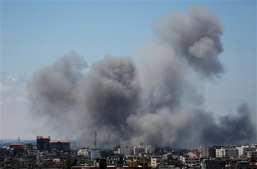 Smoke rises after an Israeli missile strike in Gaza City, Friday.