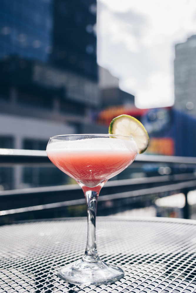 Caribbean Daydream: Captain Morgan Pineapple Rum, hibiscus syrup, lime, yellow chartreuse, créme of coconut, and lime wheel / Image: Catherine Viox // Published: 5.8.18