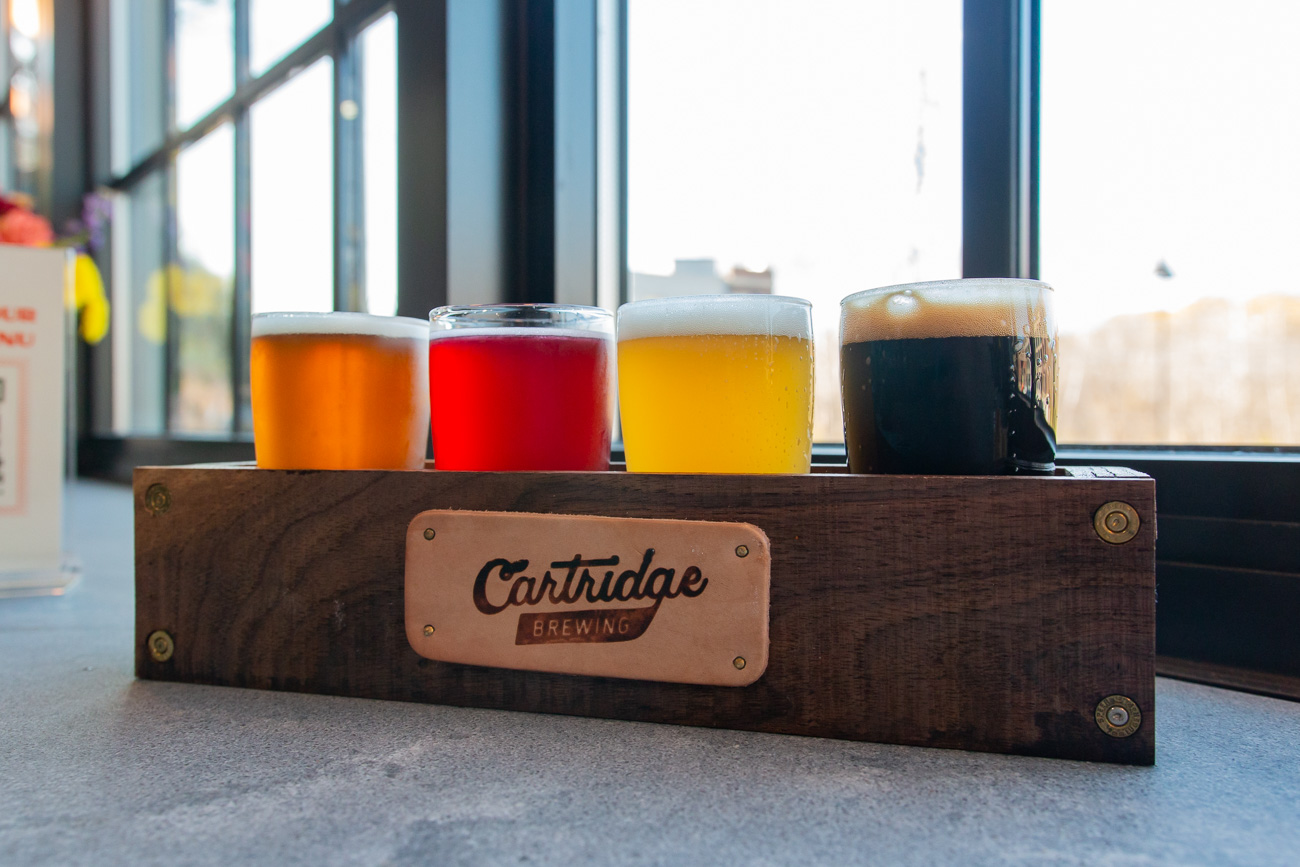 Flights include your choice of four beers. Pictured left to right are Leaded, Hollow Point, Sabot, and Holster. / Image: Elizabeth A. Lowry{ }// Published: 11.25.20