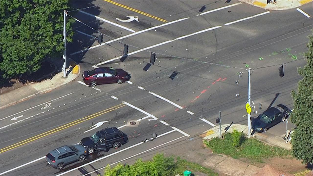 Damaged cars can be seen at Southeast 148th Avenue and Powell Boulevard after a hit-and-run crash killed one and injured several others. (Photo: Chopper 2/KATU News)