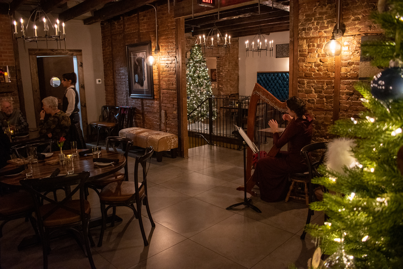 A harpist entertains guests dining upstairs. / Image: Matt Groves // Published: 2.23.20