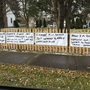 Town dispute leads man to write messages on his fence