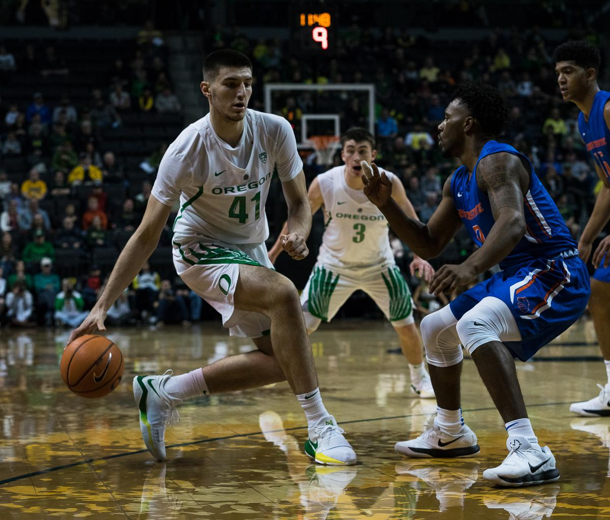 The University of Oregon's Victor Bailey Jr. (#41) is pressured by Boise State Bronco Marcus Dickinson (#0). The Boise State Broncos defeated the University of Oregon Ducks 73 – 70 at Matthew Knight Arena in Eugene, Ore., on December 1, 2017. Photo by Kit MacAvoy, Oregon News Lab