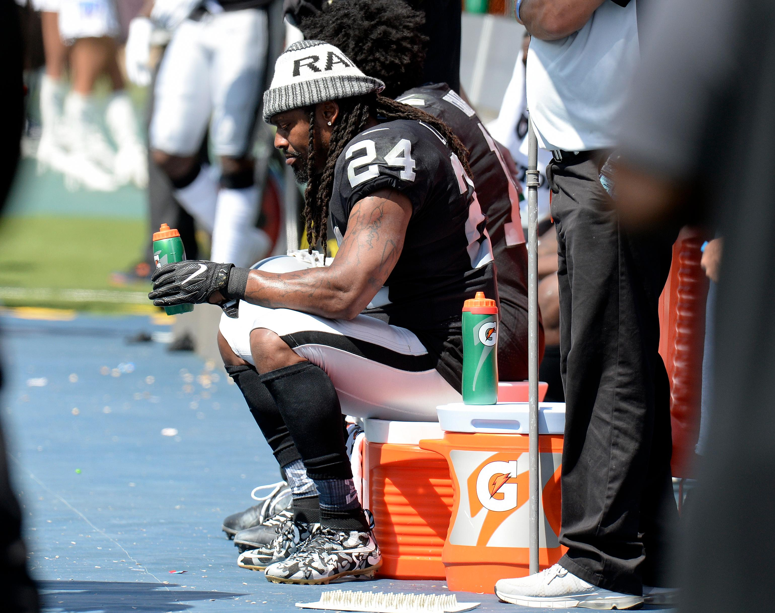 Oakland Raiders running back Marshawn Lynch (24) takes a break on the sideline in the second half of an NFL football game against the Tennessee Titans Sunday, Sept. 10, 2017, in Nashville, Tenn. (AP Photo/Mark Zaleski)