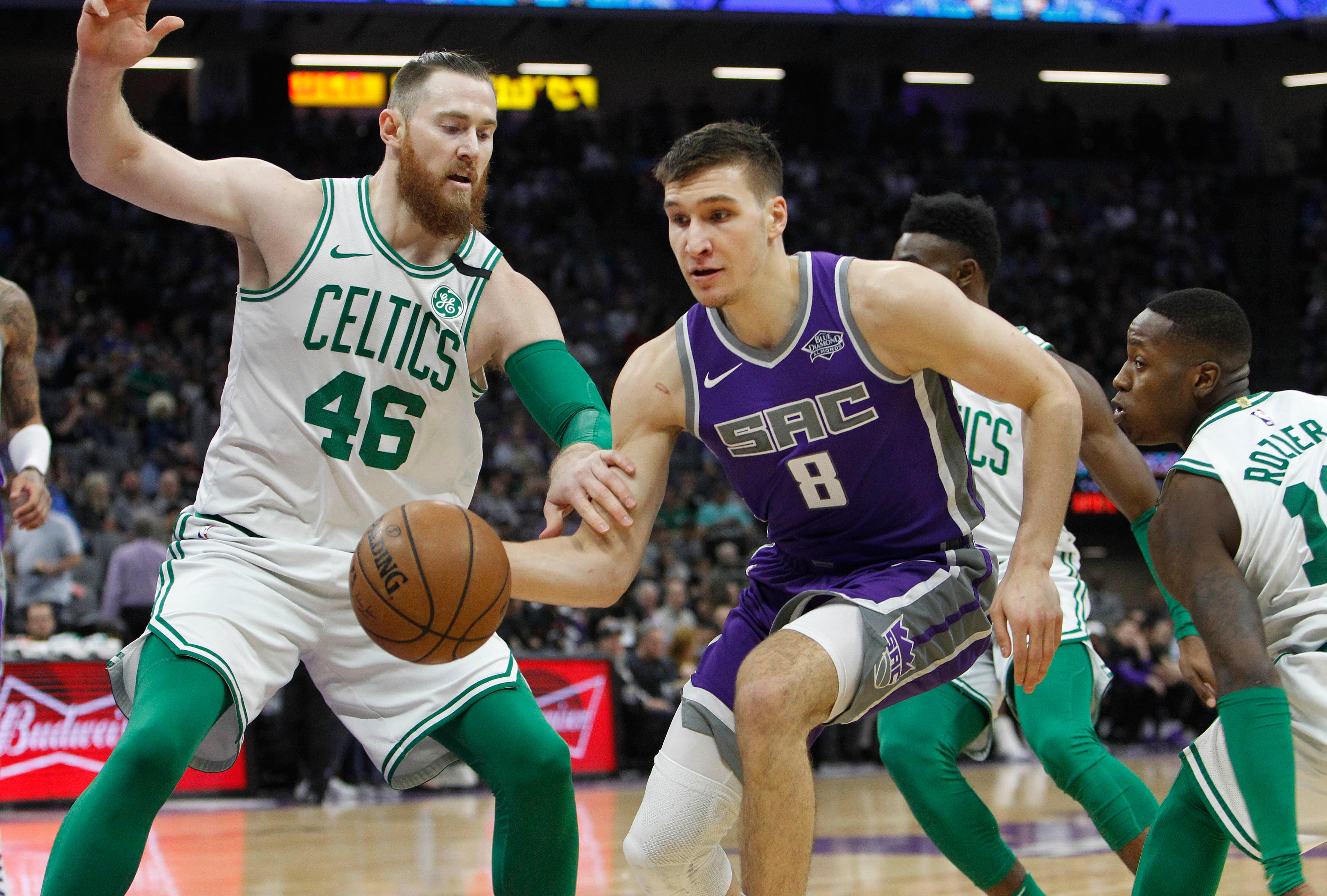 Sacramento Kings guard Bogdan Bogdanovic (8) drives to the basket against Boston Celtics center Aron Baynes (46) during the first half of an NBA basketball game in Sacramento, Calif., Sunday, March 25, 2018. (AP Photo/Steve Yeater)