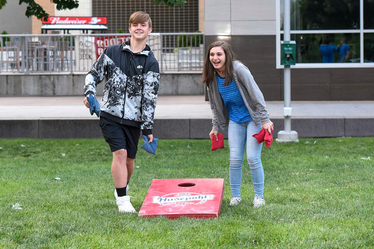 Josh Evans and Hannah Hutchinson together have a fun game of Cornhole / Image: Joe Simon // Published: 6.14.19