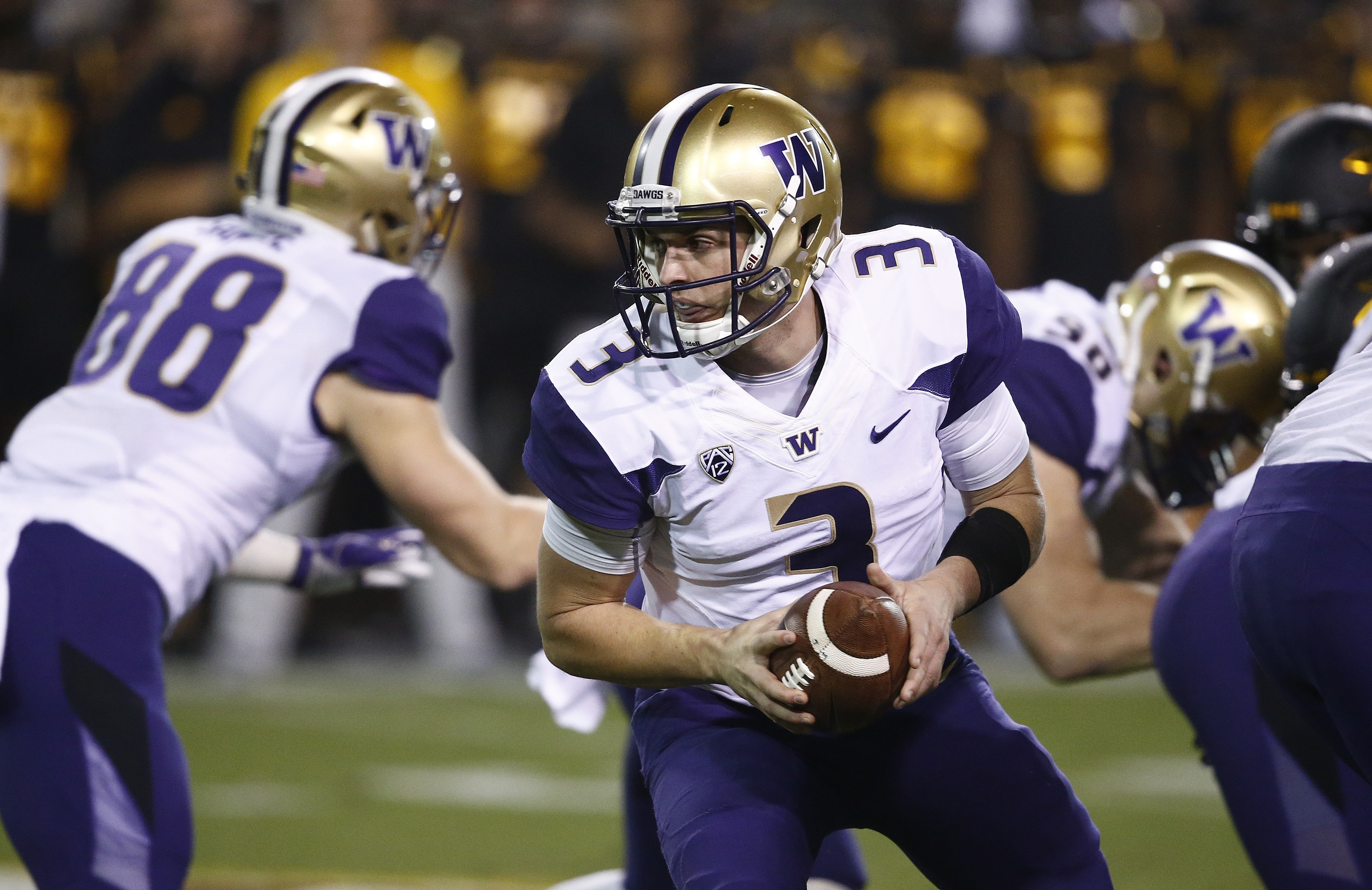 Washington quarterback Jake Browning (3) looks to hand the ball off during the first half of an NCAA college football game against Arizona State on Saturday, Oct. 14, 2017, in Tempe, Ariz. (AP Photo/Ross D. Franklin)