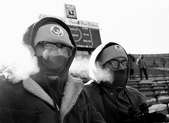 Two Green Bay Packers fans, Tom, left, and Richard Bulgrin, blow steam through their face protectors in the below-zero temperature at the NFL Championship Game, Dec. 31, 1967, at Lambeau Field. (AP Photo)