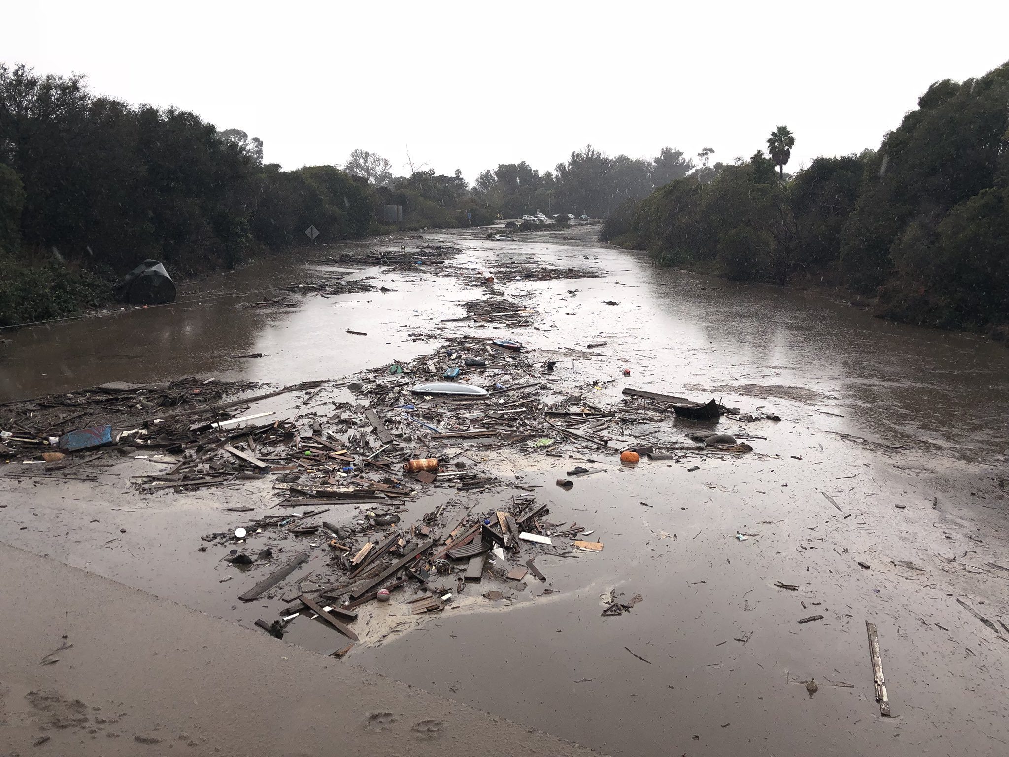 The US 101 Freeway at the Olive Mill Road overpass flooded with runoff water from Montecito Creek. (Photo: Mike Eliason / Santa Barbara County Fire)