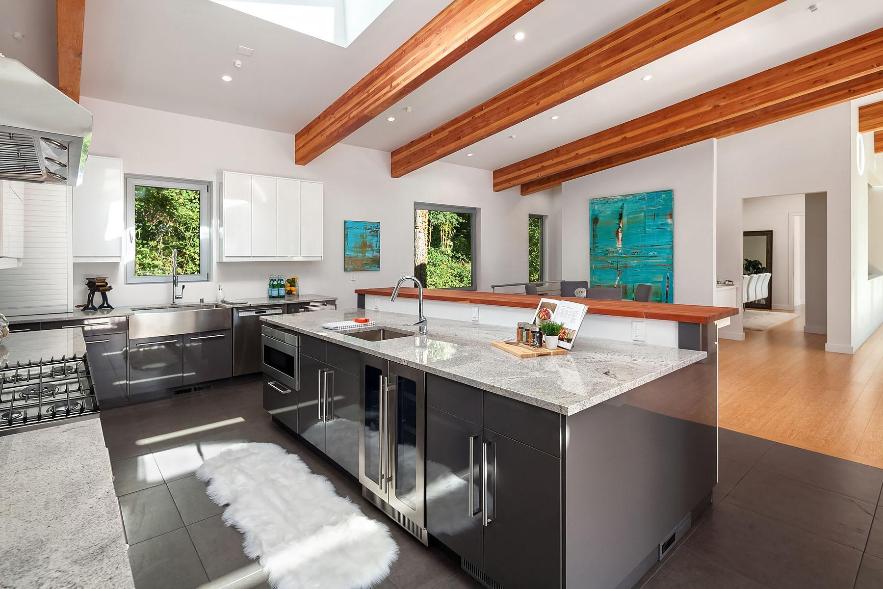 "This beautiful, 5,050 square foot, light-filled NW modern is a 4 bedroom, 4.5 bathroom abode with soaring ceilings, exposed wood beams, a chefs kitchen, covered deck, huge dining room and office/den. The home was custom designed by renowned Medici Architects and is BATHED in natural light. Aka the best light.{&nbsp;}<a  href=""https://www.windermere.com/listing/WA/Bellevue/1840-100th-Ave-SE-98004/93893636"" target=""_blank"" title=""https://www.windermere.com/listing/WA/Bellevue/1840-100th-Ave-SE-98004/93893636"">Listed by Windermere, this Bellevue home is $2,400,000 (Image courtesy of Windermere)</a>."