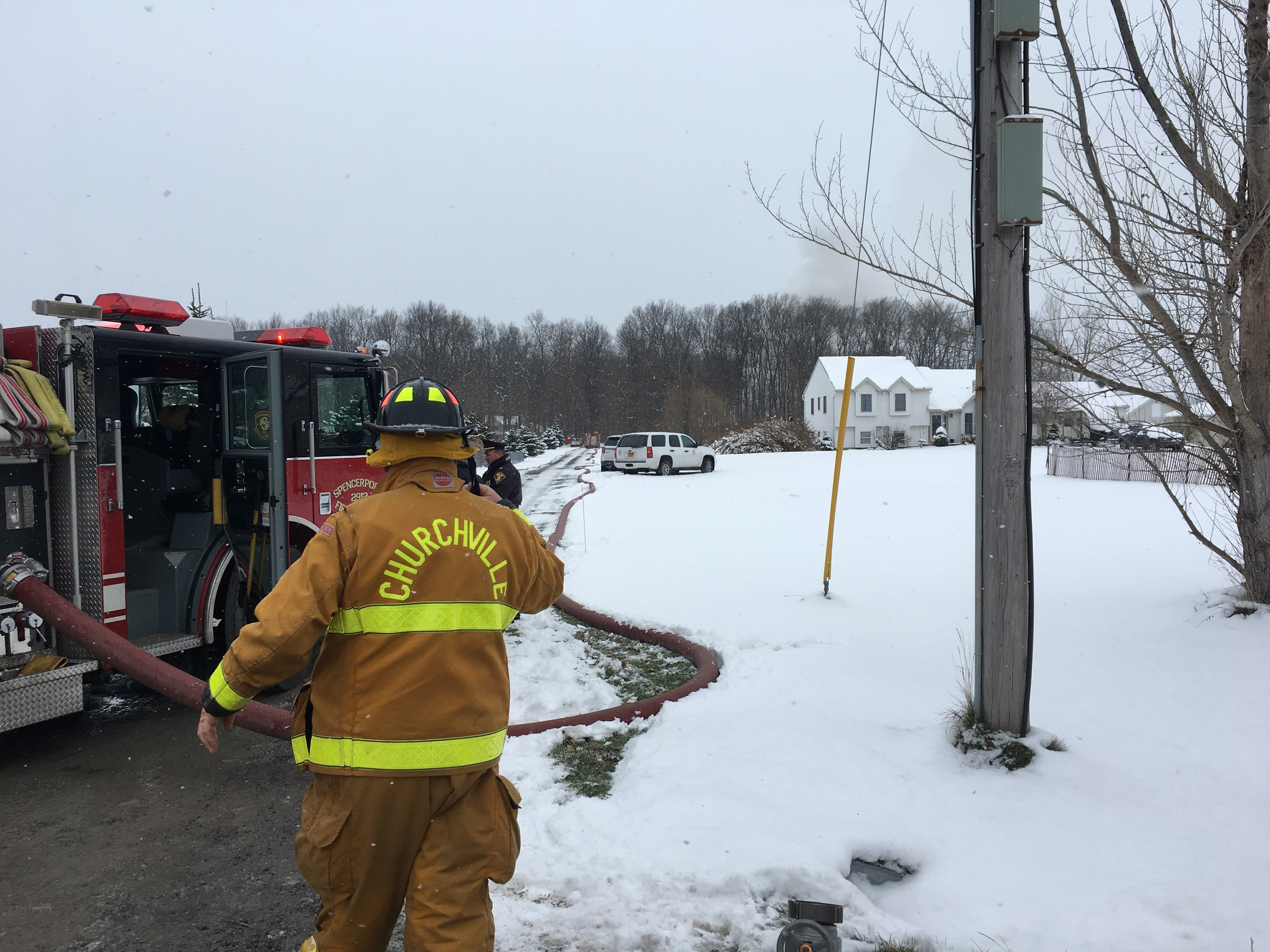 Fire crews were called to a fire at a building set far back off of a road in Riga Monday afternoon. (WHAM photo)