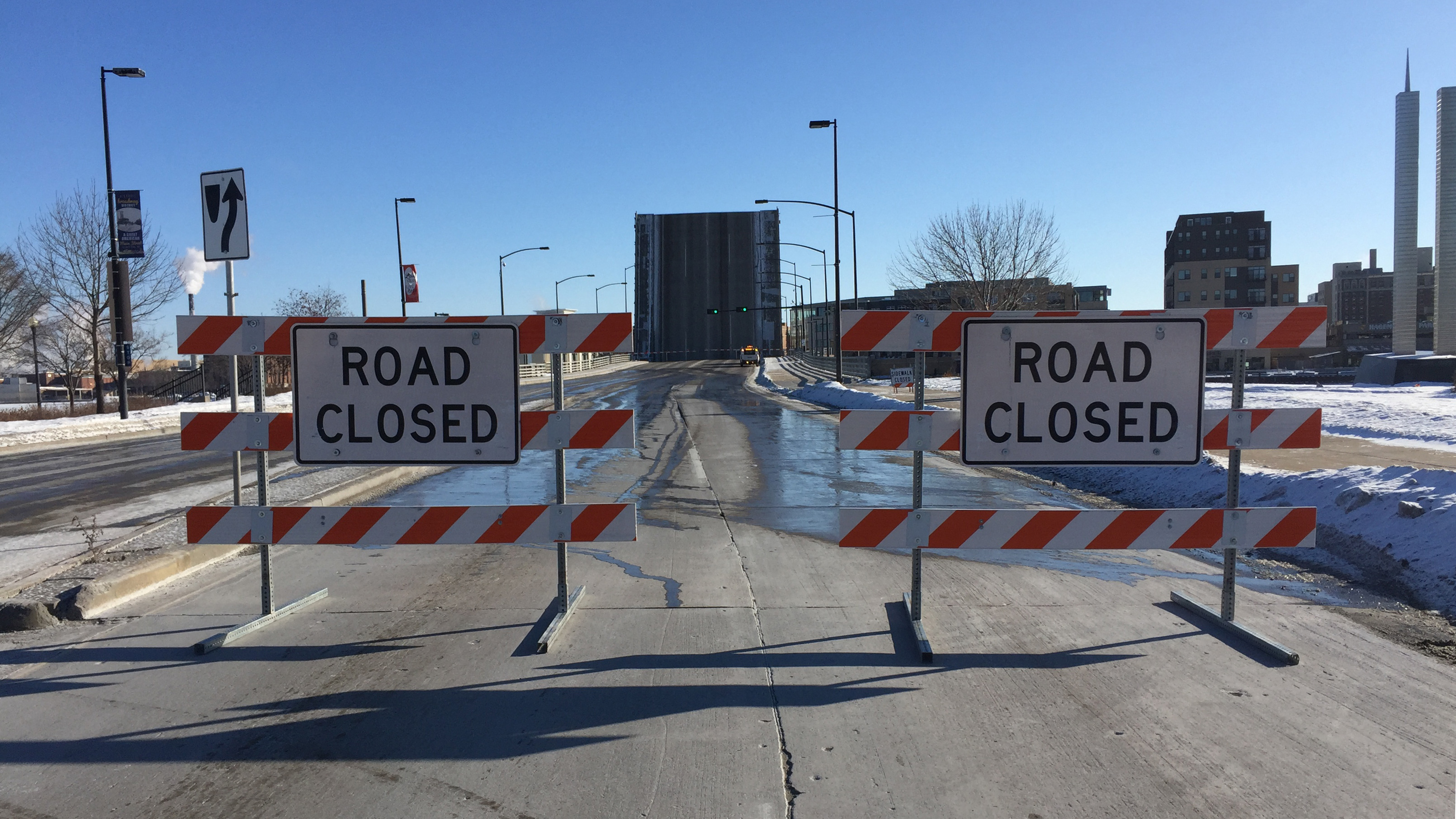 Main Street in downtown Green Bay is barricaded as the Ray Nitschke Memorial Bridge is raised for boat traffic Dec. 27, 2017. (WLUK/Eric Peterson)