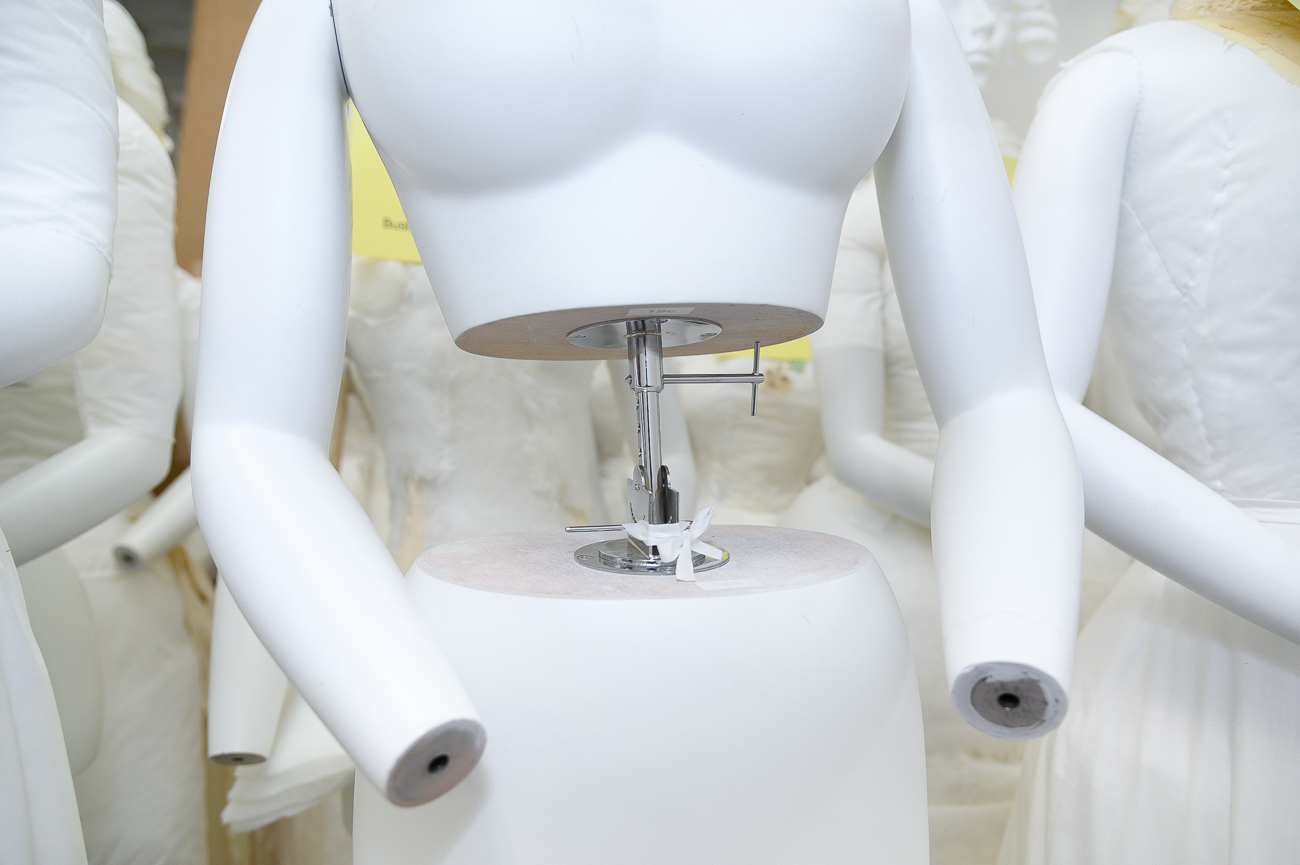 The Japanese-made 19th-century mannequins are fully adjustable. Some dresses require a tighter waistline than the mannequins naturally offer, so Cynthia will raise the torso up to accommodate the smaller size. / Image: Phil Armstrong, Cincinnati Refined // Published: 2.18.20