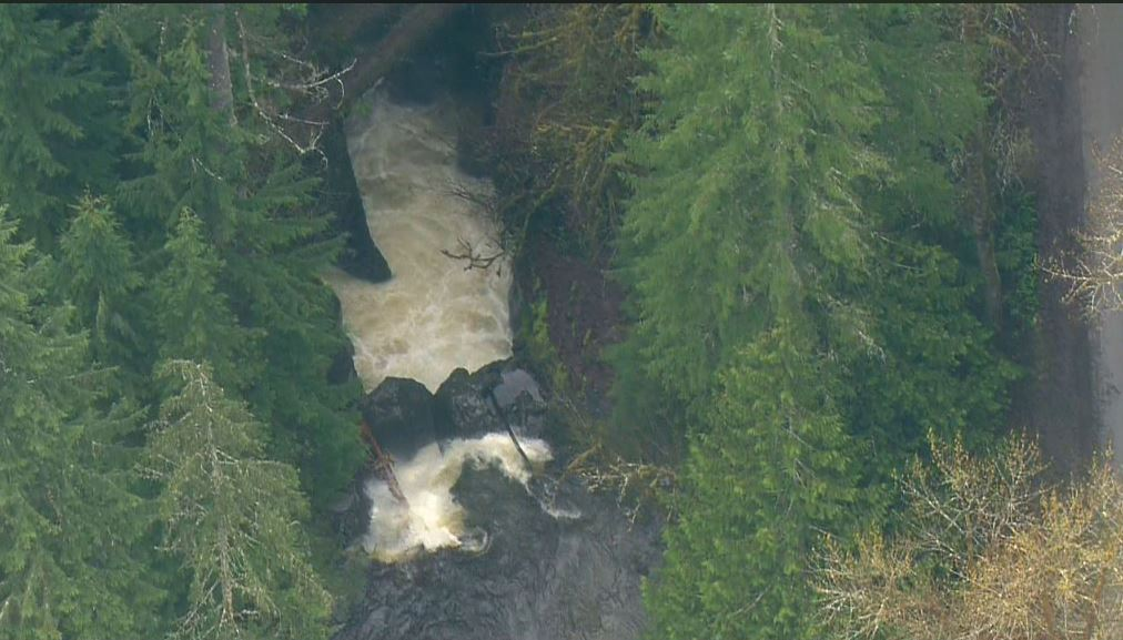 Crews search for a woman who tumbled over falls near a Snohomish County lake on April 12, 2018. (KOMO News)