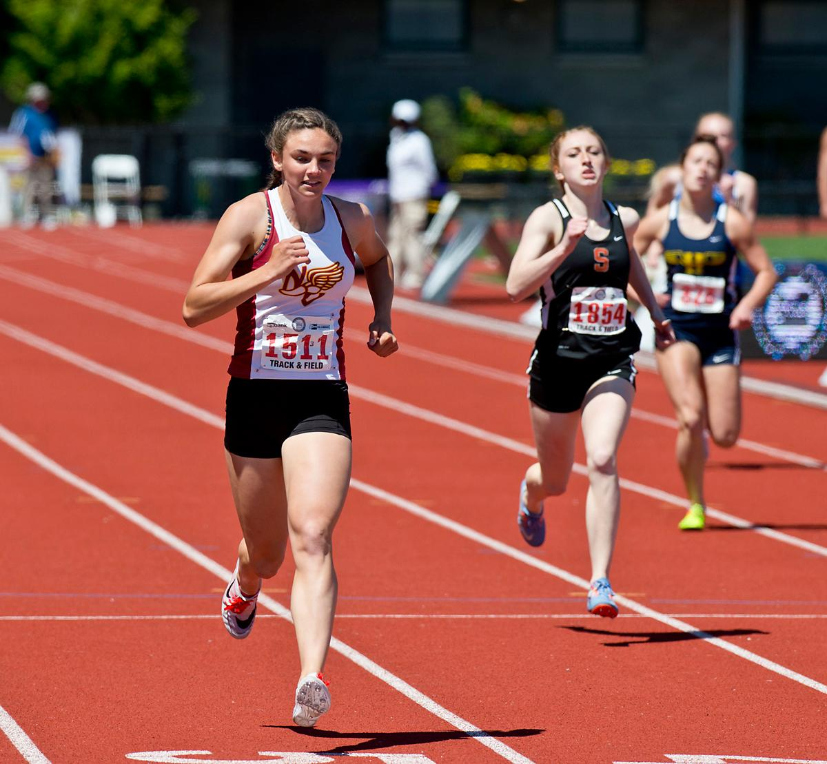 Baylee Touey from North Valley wins the 4A Girls 400 meter dash with a time of 57.47 at the OSAA Track Championship at Hayward Field on Saturday. Photo by Dan Morrison, Oregon News Lab