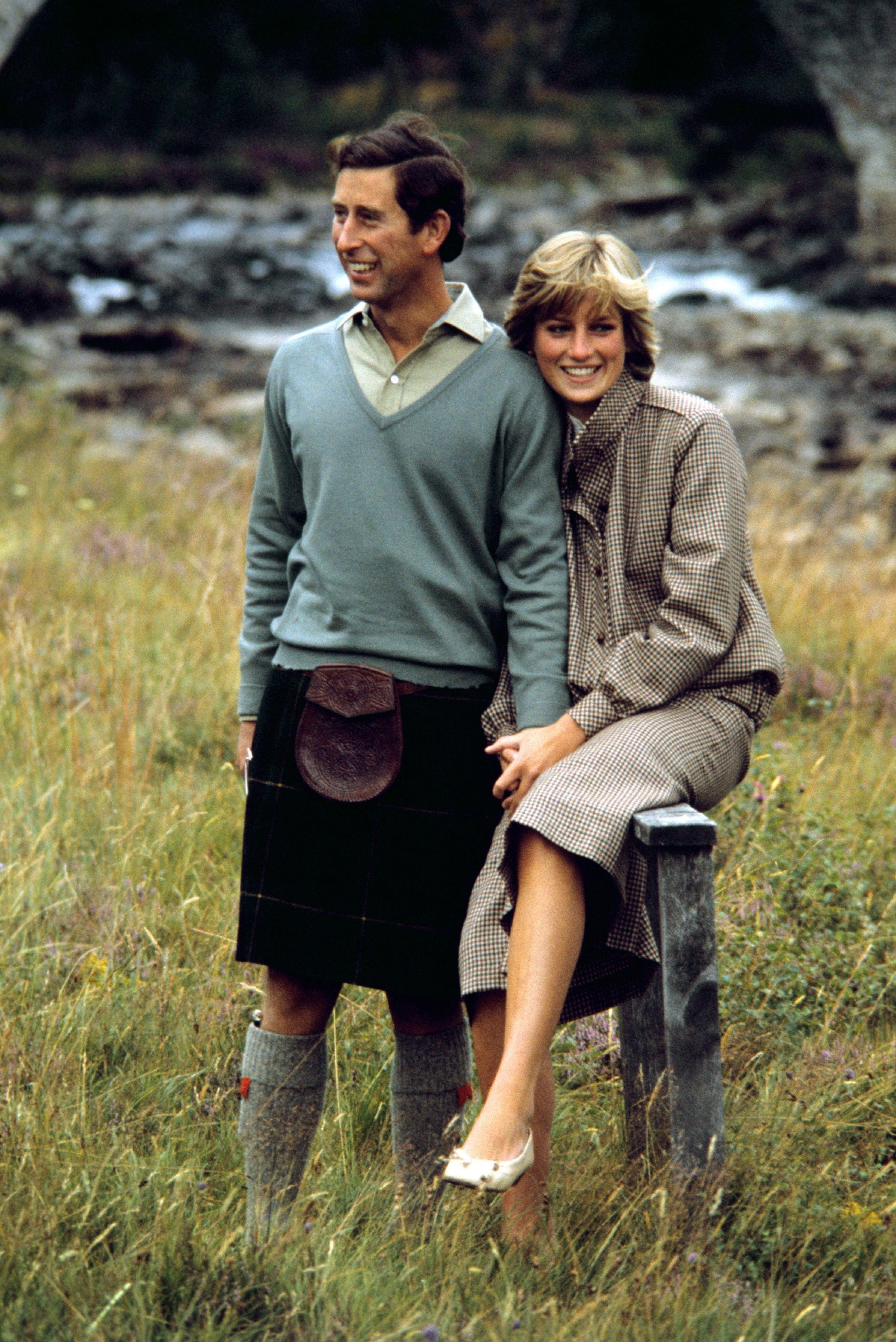 "FILE - In this Aug. 19, 1981 file photo, Britain's Prince Charles and Diana, Princess of Wales pose for photographers during their honeymoon in Balmoral, Scotland. This outfit is featured in an exhibition of 25 dresses and outfits worn by Diana entitled ""Diana: Her Fashion Story"" at Kensington Palace in London, opening on Friday, Feb. 24, 2017. (PA via AP, file)"