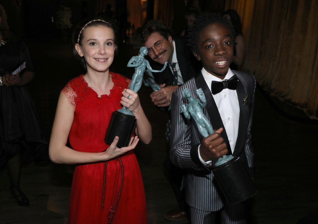 "Millie Bobby Brown, left, and Caleb McLaughlin, right, appear backstage with the awards for outstanding performance by an ensemble in a drama series for ""Stranger Things"" at the 23rd annual Screen Actors Guild Awards at the Shrine Auditorium & Expo Hall on Sunday, Jan. 29, 2017, in Los Angeles. (Photo by Matt Sayles/Invision/AP)"