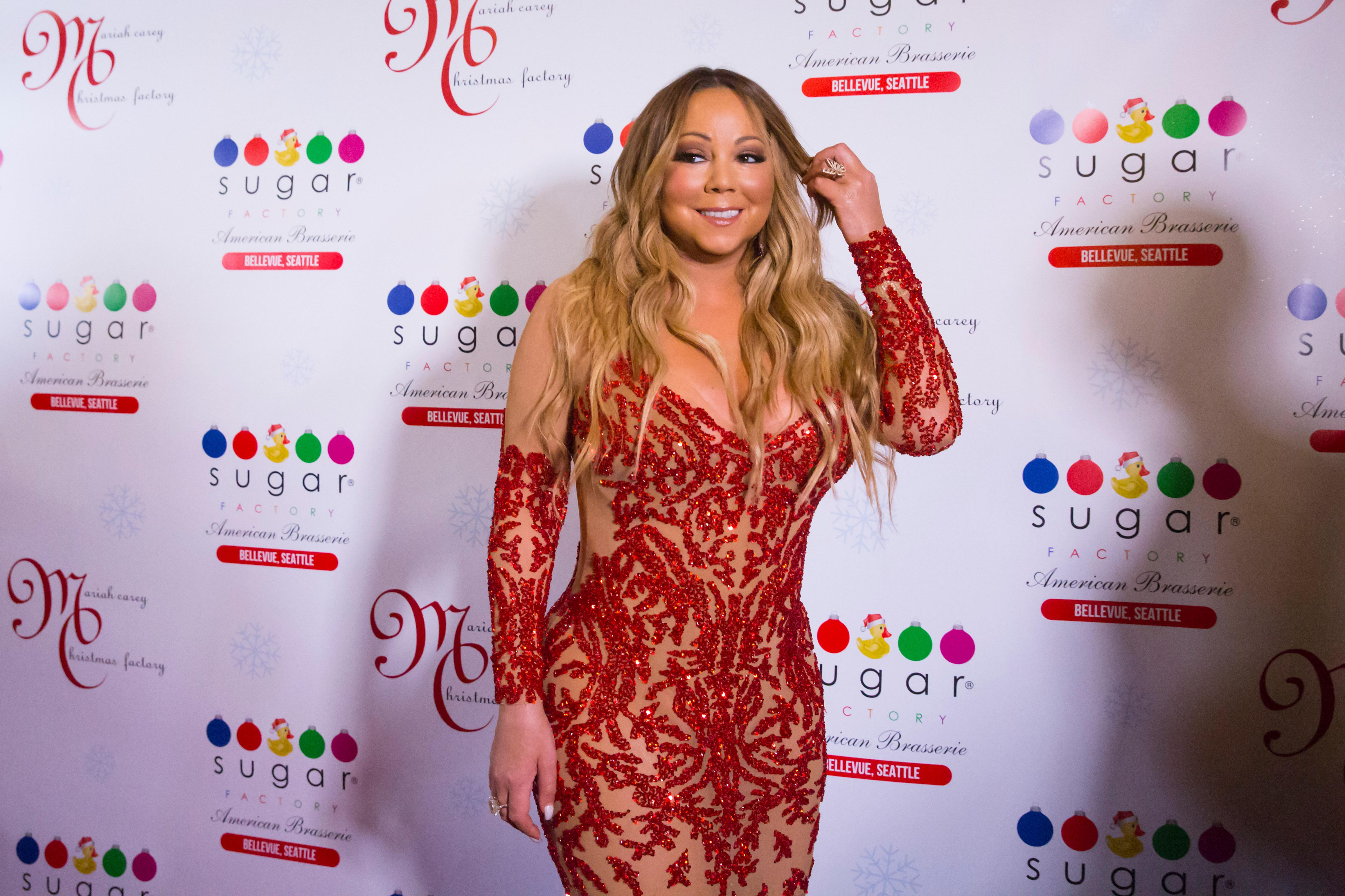 The Queen Diva herself, Ms. Mariah Carey, was on-hand at Sugar Factory in Bellevue (September 6, 2017), to debut her new Christmas-themed candy line for the company. Carey is in town as part of her tour with Lionel Ritchie - they played the KeyArena earlier in the week. Mariah Carey Christmas Factory will feature a Christmas themed retail and candy line, curated by Mariah, herself. Mariah Carey Christmas Factory sneak peek items will be available for sale in Seattle starting Wednesday, September 6 and available for purchase online by the end of September. The entire line of more than 100 retail and candy items including t-shirts and other custom products will be available across retail stores nationwide starting November 1, just in time for the holidays. (Sy Bean / Seattle Refined)