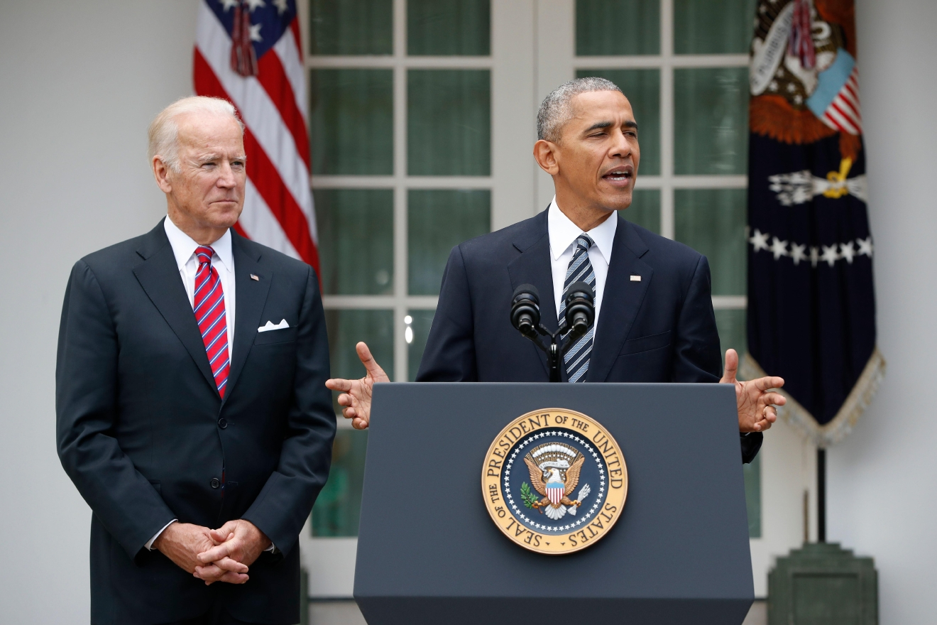 President Barack Obama, accompanied by Vice President Joe Biden, speaks in the election, Wednesday, Nov. 9, 2016, in the Rose Garden of the White House in Washington. (AP Photo/Pablo Martinez Monsivais)