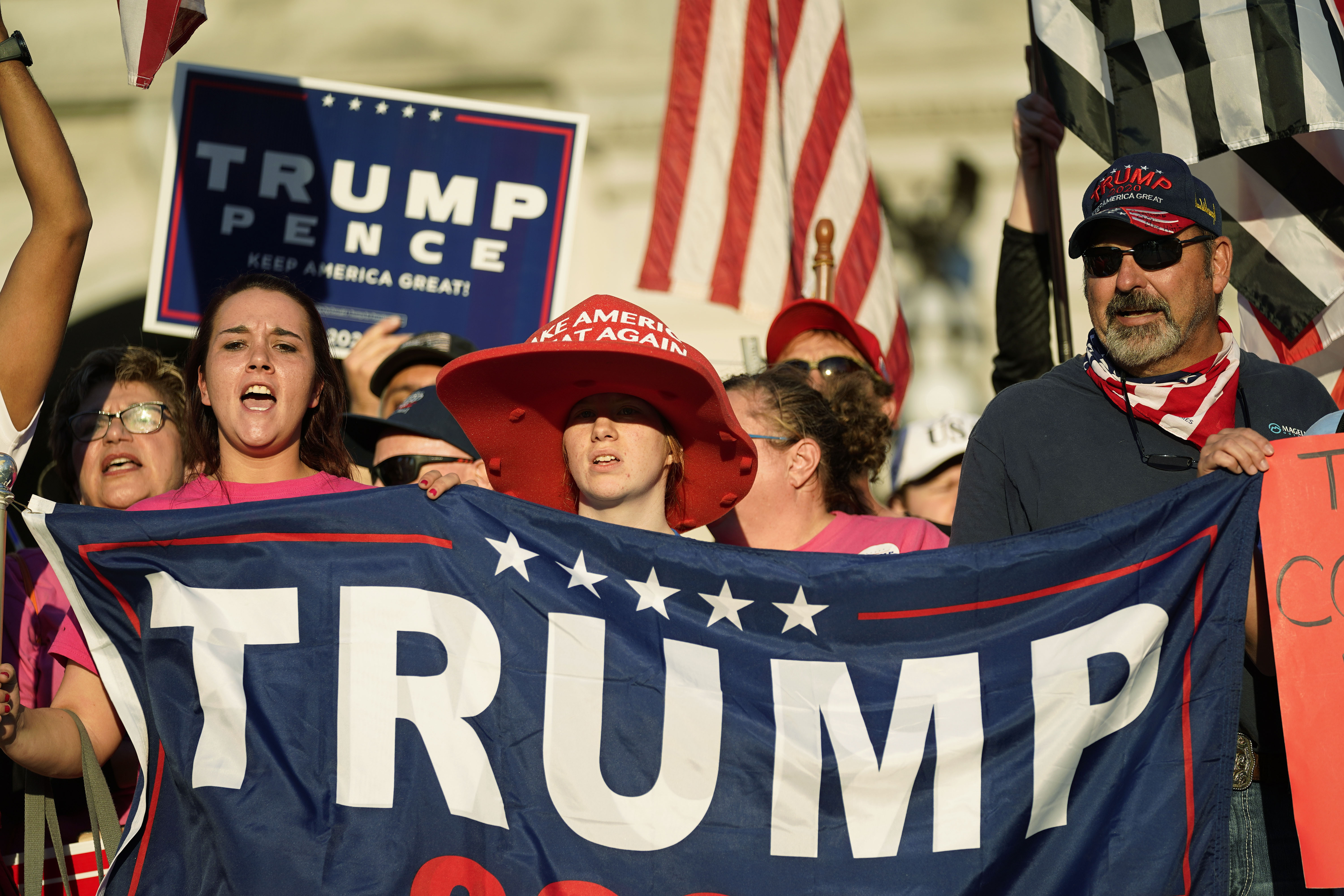 Supporters of President Donald Trump demonstrate outside the Pennsylvania State Capitol, Saturday, Nov. 7, 2020, in Harrisburg, Pa., after Democrat Joe Biden defeated Trump to become 46th president of the United States. (AP Photo/Julio Cortez)