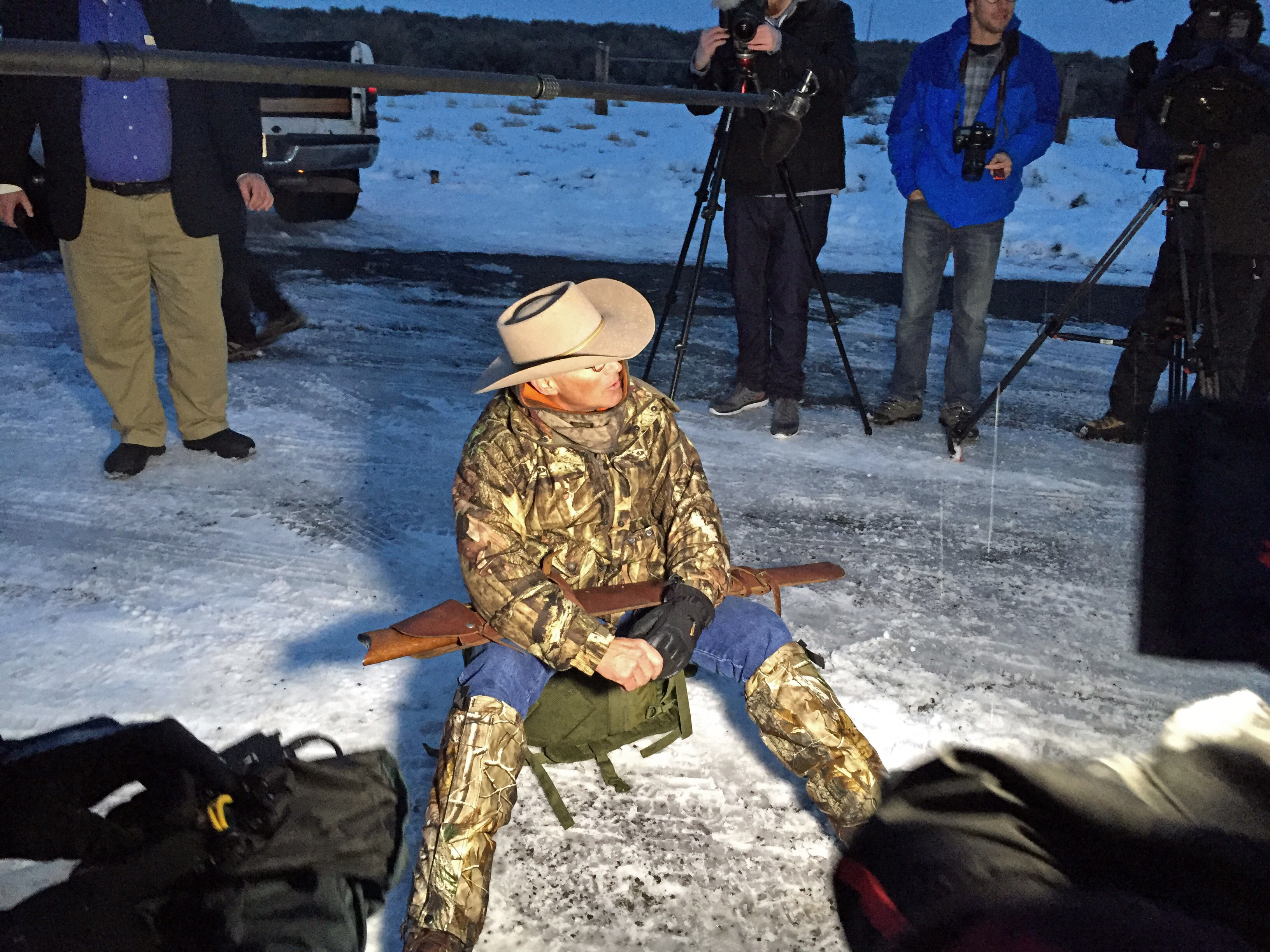 Arizona rancher LaVoy Finicum, holding rifle, speaks to reporters at the Malheur National Wildlife Refuge, Tuesday, Jan. 5, 2016, near Burns, Ore. Ammon Bundy, the leader of a small, armed group that is occupying a remote national wildlife preserve in Oregon said Tuesday that they will go home when a plan is in place to turn over management of federal lands to locals. (AP Photo/Rebecca Boone)