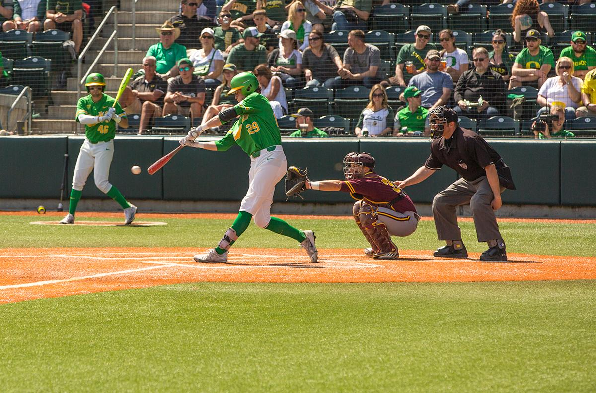 Ryne Nelson(#29) hits a line drive up center field. Despite a late comeback, the Ducks fall to Arizona State Sun Devils 4-3 in the second game of a three-game series. Photo by James Wegter, Oregon News Lab