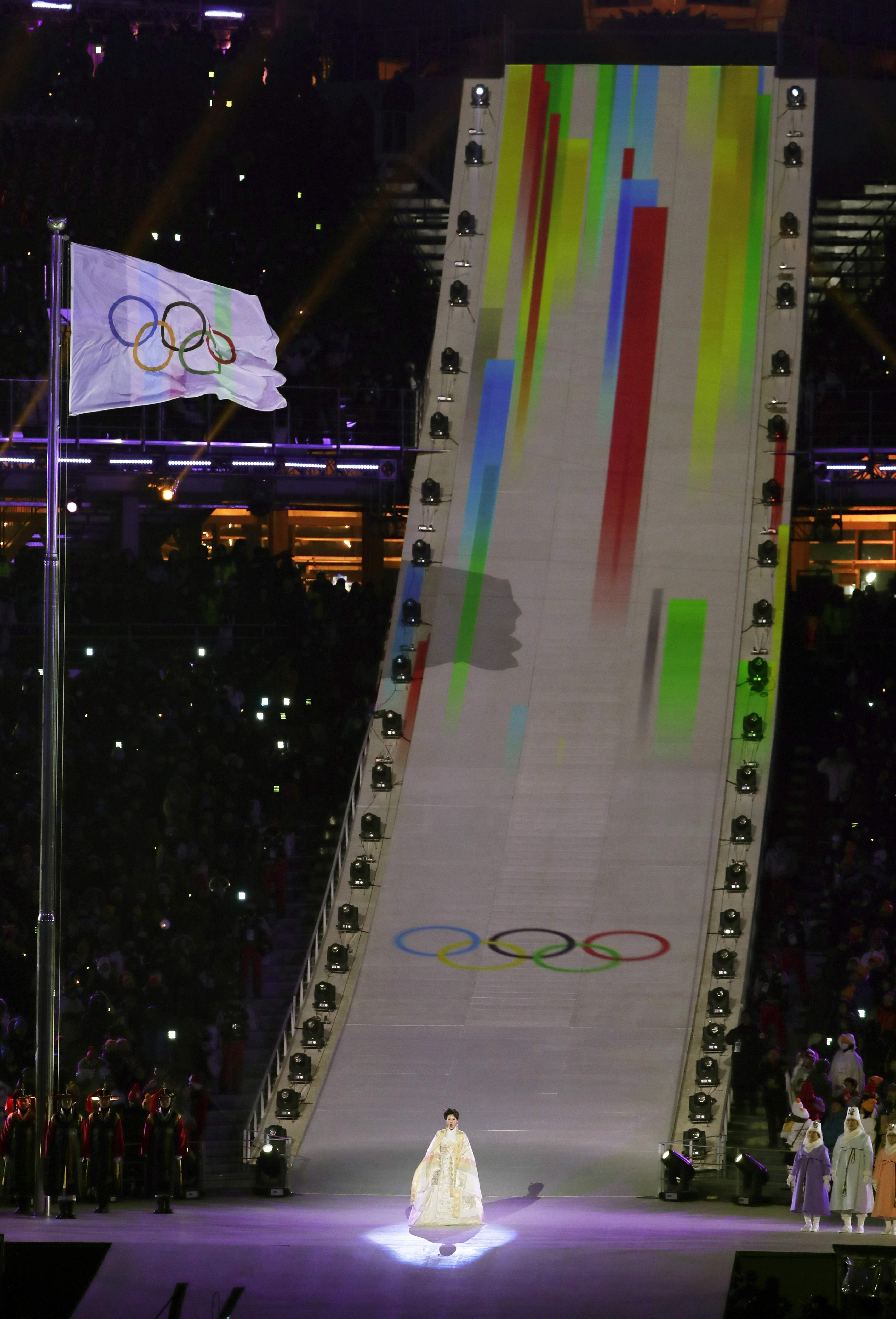 The Olympic flag is raised during the opening ceremony of the 2018 Winter Olympics in Pyeongchang, South Korea, Friday, Feb. 9, 2018. (AP Photo/Julie Jacobson)