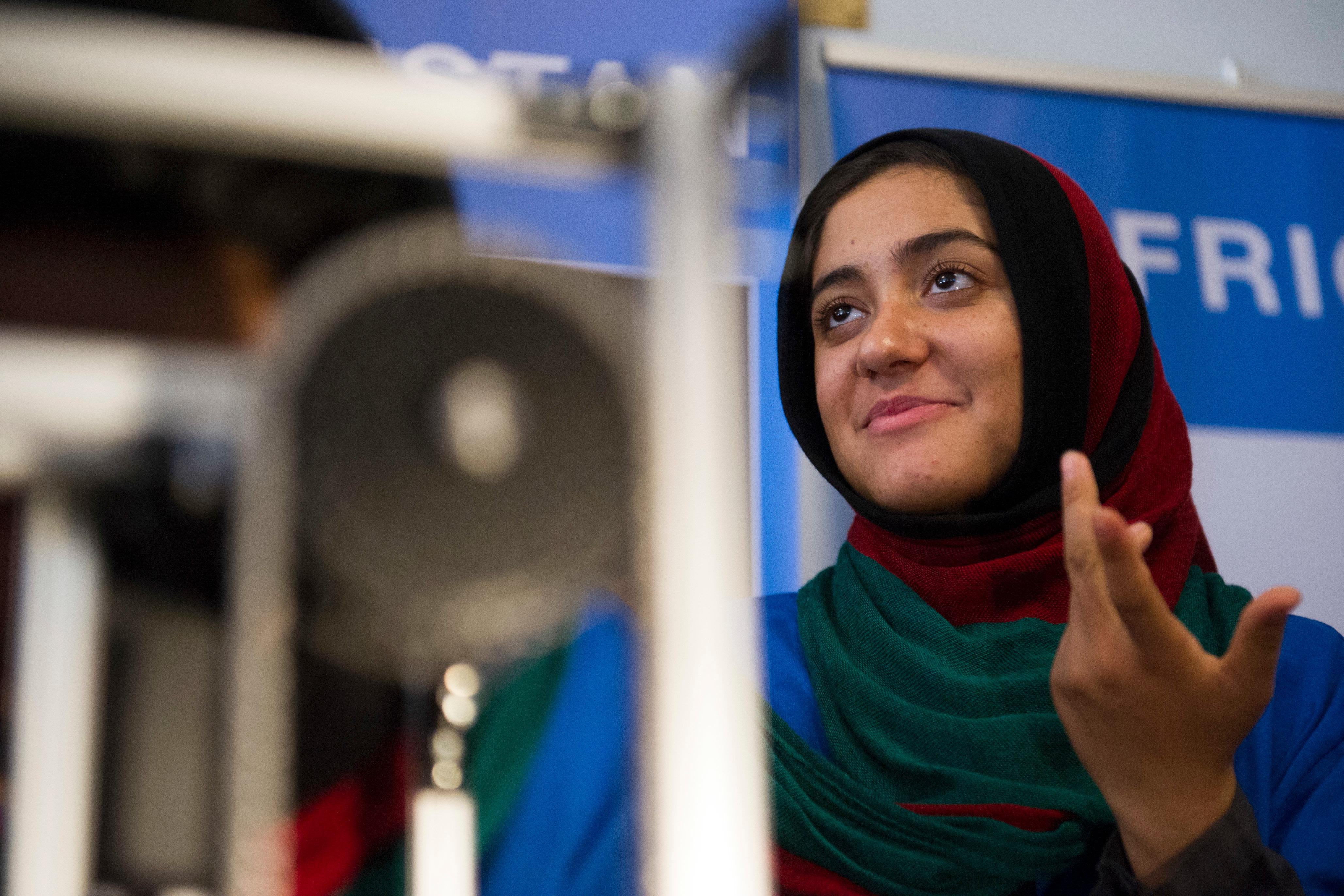Afghanistan team member Lisa Azizi trouble shoots the teams robot entry prior to the opening ceremony for the FIRST Global Challenge 2017, in Washington, Sunday, July 16, 2017. They will be competing against entrants from more than 150 countries in the FIRST Global Challenge. It's the first annual robotics competition designed to encourage youths to pursue careers in math and science.  (AP Photo/Cliff Owen)