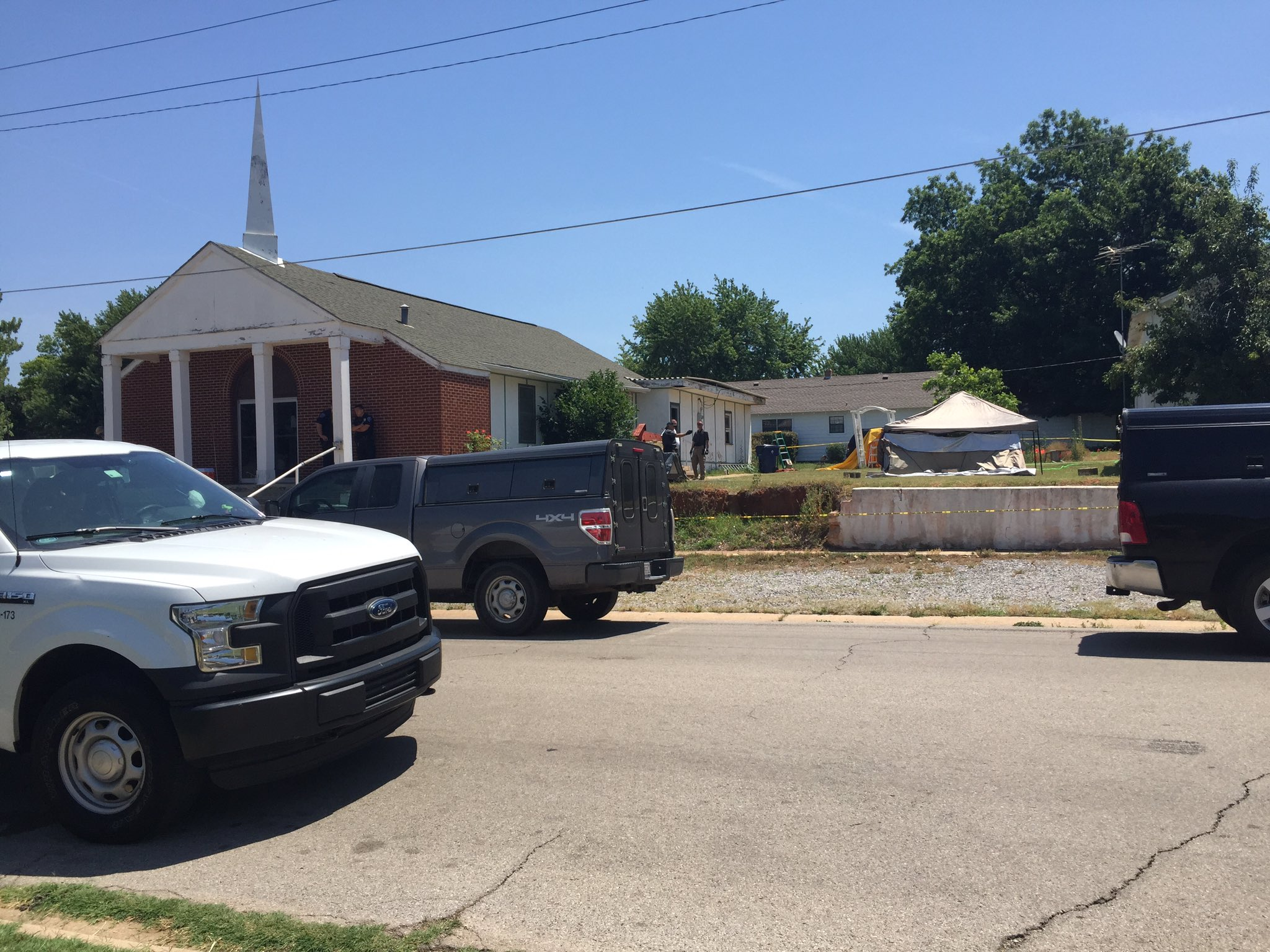 Police investigate after a Chickasha pastor's body was found burned early June 16. (KOKH/Julie Calhoun)